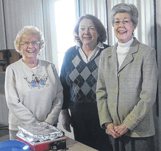 Hostess for the April meeting were, from left, Wanda Everman, Sharon Hiles and Helen Starkey