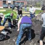 Community beautification: CCYC, WC frat and master gardeners team up