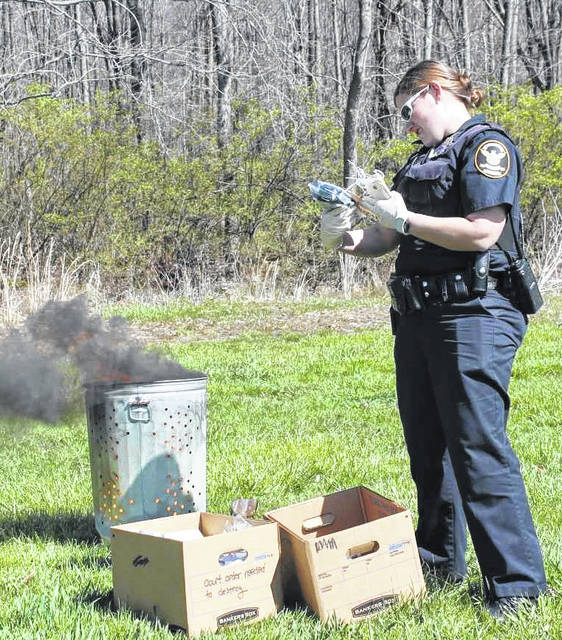 Ptl. Kristen Jeffers checks evidence tags prior to burning evidence.