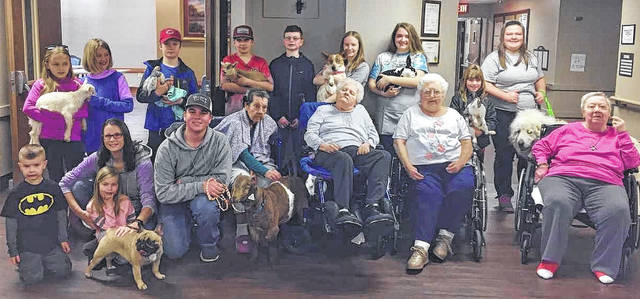 Pictured in the front row are 4-H members Corbin, Emma and Alicia Essert and Chase Forman. The four residents in the front row are Phyllis Hixson, Beulah Curtis, Janice McCoppin and Regina Keplinger. 4H members in the back row are Bronwyn Barnes, Maya Miller, Josiah Gibbs, Tate Forman, Tyler Shank, Ruby Hoskins, Paige McIntosh, Jenna Gibbs and Alyssa Chaney.