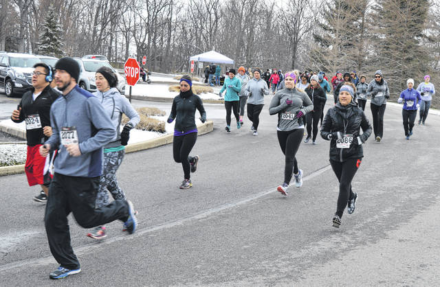 Despite wintry temperatures, there was a fine turnout of dedicated runners and walkers Saturday morning for the April Fools 3rd Annual 5K Run/1 Mile Walk. The event is hosted by the Health Alliance of Clinton County. For more photos, visit wnewsj.com .