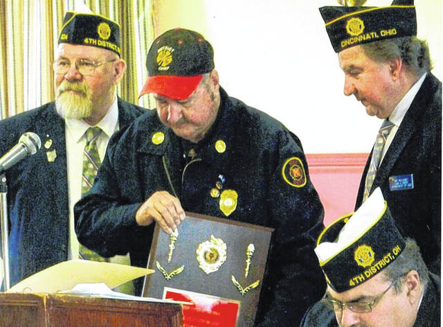 At an event in Milford, Blanchester-Marion Township Fire District Chief Don Walker accepts the honor of being named Firefighter of the Year by American Legion District 4 in Ohio.