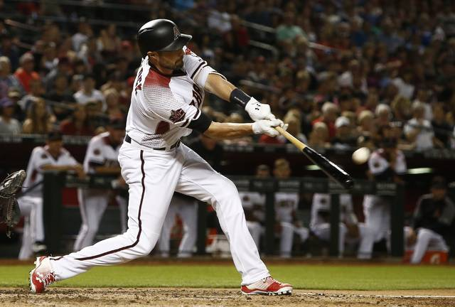 Arizona Diamondbacks' A.J. Pollock connects for a home run, his second of the night, during the fifth inning of a baseball game against the Los Angeles Dodgers Monday, April 30, 2018, in Phoenix. (AP Photo/Ross D. Franklin)
