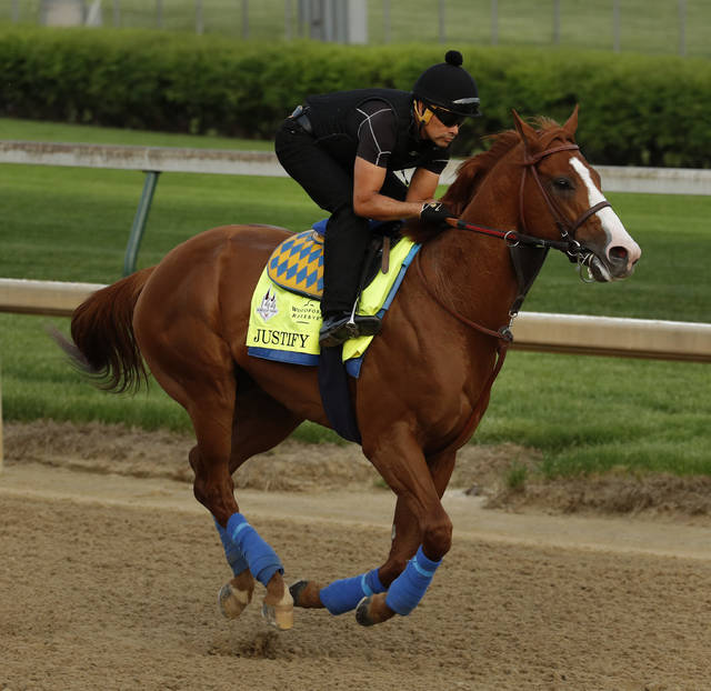 Kentucky Derby entrant Justify trains at Churchill Downs Thursday, May 3, 2018, in Louisville, Ky. The 144th running of the Kentucky Derby is scheduled for Saturday, May 5. (AP Photo/Charlie Riedel)