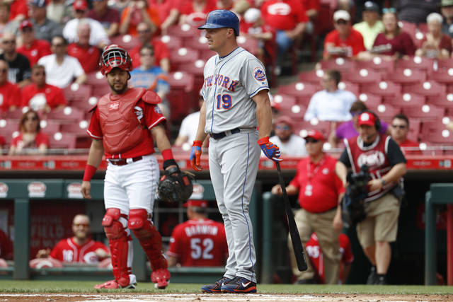 New York Mets' Jay Bruce stands at the plate after umpire Gabe Morales called an out on the Mets for batting out of order earlier, in the first inning of a baseball game against the Cincinnati Reds, Wednesday, May 9, 2018, in Cincinnati. (AP Photo/John Minchillo)