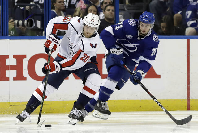 Washington Capitals center Lars Eller (20) cuts around Tampa Bay Lightning center Anthony Cirelli (71) during the second period of Game 2 of the NHL Eastern Conference finals hockey playoff series Sunday, May 13, 2018, in Tampa, Fla. (AP Photo/Chris O'Meara)