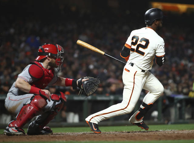 San Francisco Giants' Andrew McCutchen (22) swings against the Cincinnati Reds in the sixth inning of a baseball game Monday, May 14, 2018, in San Francisco. McCutchen reached first base on a fielder's choice. (AP Photo/Ben Margot)