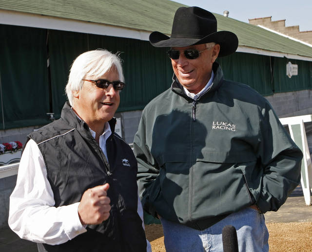 FILE - In this April 28, 2010 file photo, Kentucky Derby hopeful Conveyance trainer Bob Baffert, left, talks to Dublin trainer D. Wayne Lukas at Churchill Downs  in Louisville, Ky. Baffert has spent his whole life following Lukas. As a teenager at the quarter horse track in Arizona where Baffert learned about racing, he looked up to Lukas as a legend. They've developed a friendship as deep as their combined success as two of the best thoroughbred trainers in racing history that extends to this week when they go head-to-head again in the Preakness Stakes each has won six times. (AP Photo/Ed Reinke, File)