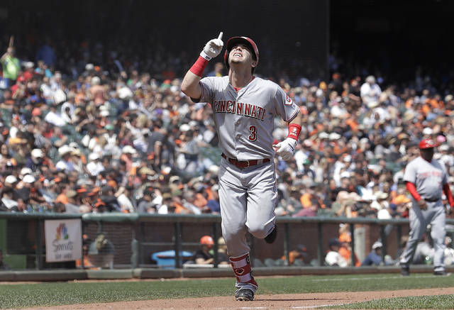 Cincinnati Reds' Scooter Gennett celebrates after hitting a home run against the San Francisco Giants during the seventh inning of a baseball game in San Francisco, Wednesday, May 16, 2018. (AP Photo/Jeff Chiu)