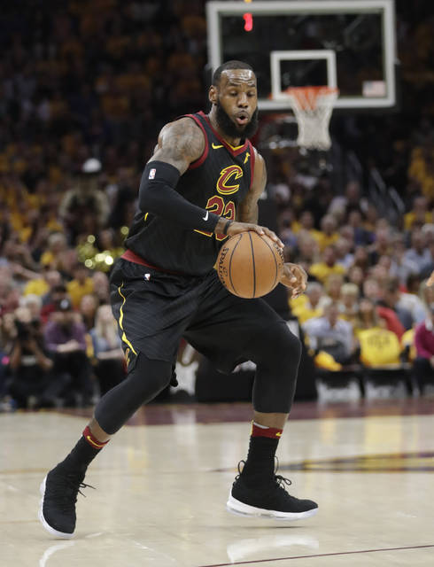 Cleveland Cavaliers' LeBron James (23) handles the ball in the first half of Game 3 against the Boston Celtics in the NBA basketball Eastern Conference finals, Saturday, May 19, 2018, in Cleveland. (AP Photo/Tony Dejak)