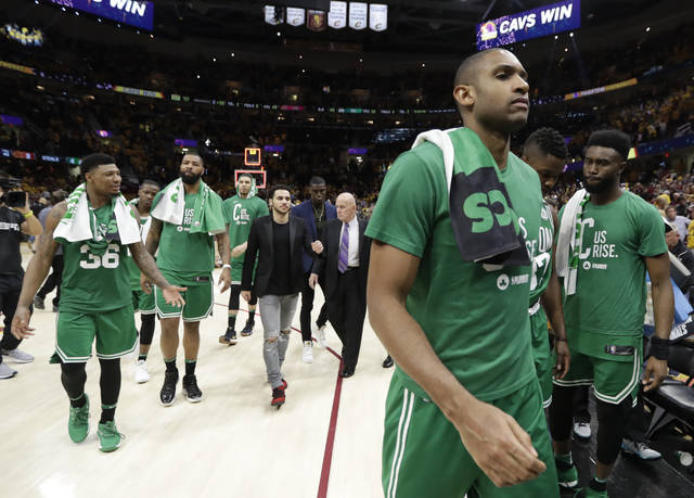 Boston Celtics' Al Horford walks off the court at the end of Game 3 of the team's NBA basketball Eastern Conference finals against the Cleveland Cavaliers, Saturday, May 19, 2018, in Cleveland. The Cavaliers won 116-86. (AP Photo/Tony Dejak)