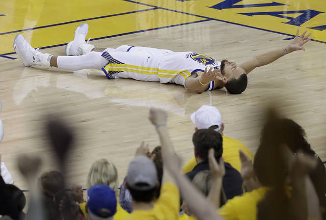 Golden State Warriors guard Stephen Curry celebrates after scoring against the Houston Rockets during the second half of Game 3 of the NBA basketball Western Conference Finals in Oakland, Calif., Sunday, May 20, 2018. (AP Photo/Jeff Chiu)