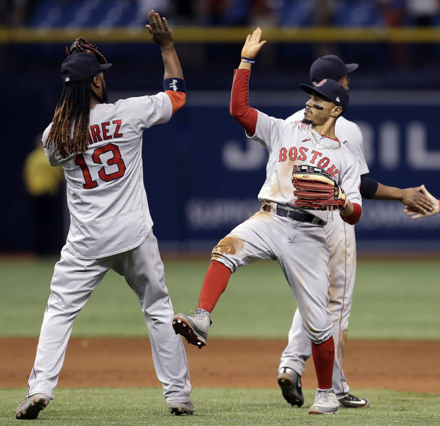 Boston Red Sox right fielder Mookie Betts celebrates with Hanley Ramirez (13) after the Red Sox defeated the Tampa Bay Rays 4-2 during a baseball game Tuesday, May 22, 2018, in St. Petersburg, Fla. (AP Photo/Chris O'Meara)