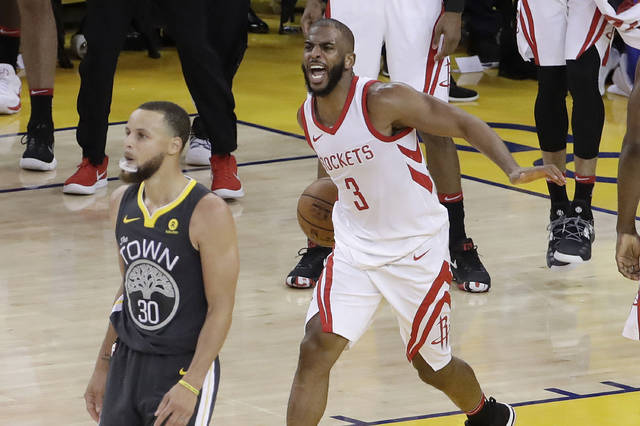 Houston Rockets guard Chris Paul (3) celebrates next to Golden State Warriors guard Stephen Curry (30) during the second half of Game 4 of the NBA basketball Western Conference Finals in Oakland, Calif., Tuesday, May 22, 2018. (AP Photo/Jeff Chiu)