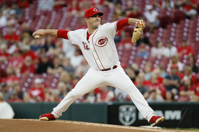 Cincinnati Reds starting pitcher Matt Harvey throws during the first inning of the team's baseball game against the Pittsburgh Pirates, Tuesday, May 22, 2018, in Cincinnati. (AP Photo/John Minchillo)