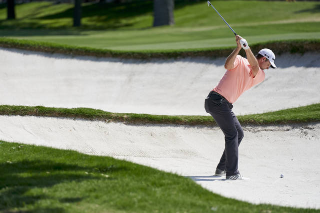 Justin Rose hits out of a sand trap on the 14th hole during the third round of the Fort Worth Invitational golf tournament at Colonial Country Club in Fort Worth, Texas, Saturday, May 26, 2018. (AP Photo/Cooper Neill)