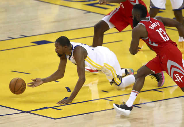 Golden State Warriors forward Kevin Durant, left, reaches for the ball in front of Houston Rockets guard James Harden (13) during the second half of Game 6 of the NBA basketball Western Conference Finals in Oakland, Calif., Saturday, May 26, 2018. (AP Photo/Ben Margot)