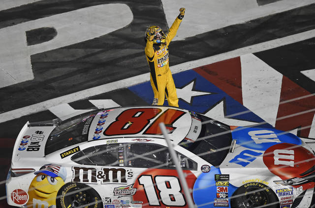 Kyle Busch celebrates after winning the NASCAR Cup Series auto race at Charlotte Motor Speedway in Charlotte, N.C., Sunday, May 27, 2018. (AP Photo/Mike McCarn)