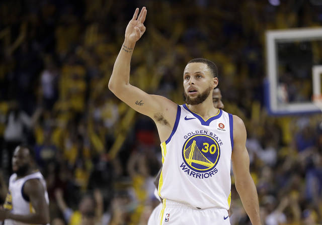 Golden State Warriors guard Stephen Curry (30) gestures during the second half of Game 6 of the NBA basketball Western Conference Finals against the Houston Rockets in Oakland, Calif., Saturday, May 26, 2018. The Warriors won 115-86. (AP Photo/Marcio Jose Sanchez)