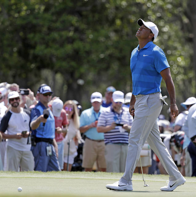 FILE - In this May 10, 2018, file photo, Tiger Woods reacts after missing a birdie putt during the first round of the The Players Championship golf tournament in Ponte Vedra Beach, Fla.  Woods' progress should not be measured by the golf he has played the last three months. Instead, consider that a year ago this week, his mug shot from a DUI arrest in Florida made it seem as though he might never be back at this level. (AP Photo/John Raoux, File)