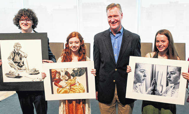 Clinton-Massie art student Sarah Karns (second from left) is holds her first-place artwork with U.S. Rep. Steve Stivers and other award winners from the 15th Ohio Congressional District.
