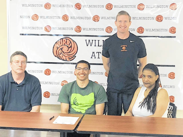 Wilmington High School senior Jeffery Mansfield plans to attend Wilmington College in the fall and play basketball for the Quakers. In the photo, from left to right, front row, father Jeff Mansfield, Jeffery Mansfield, mother Daria Mansfield; back row, WHS head coach Michael Noszka.