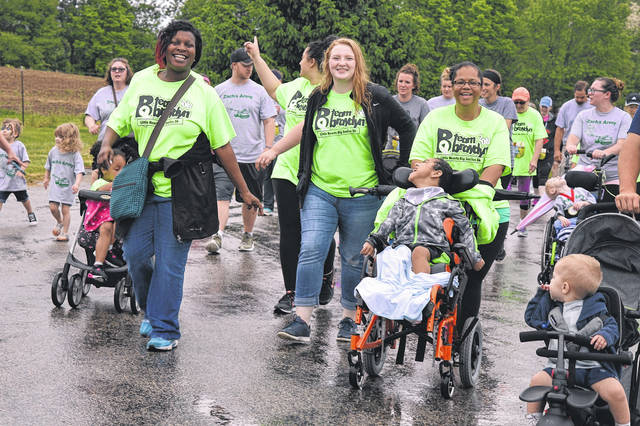 As you can see, there are lots of smiles and plenty of heart at the Little Hearts Big Smiles 5K fundraiser. In the foreground wearing the green T-shirts are members of Team Braydyn, who along with Braydyn, brought rays of sunshine to an overcast morning.