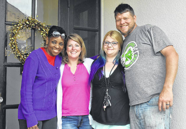 From left are House Manager Angela Mitchell-Koster, Executive Director Allison Rambo, now-former resident Hayley Nimersheim, and Marketplace Director Micah Steele.