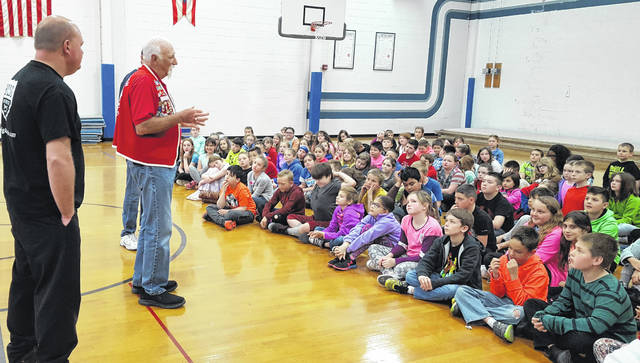 Lion Gary DeFayette tells students at Blanchester the story of the Lions International.