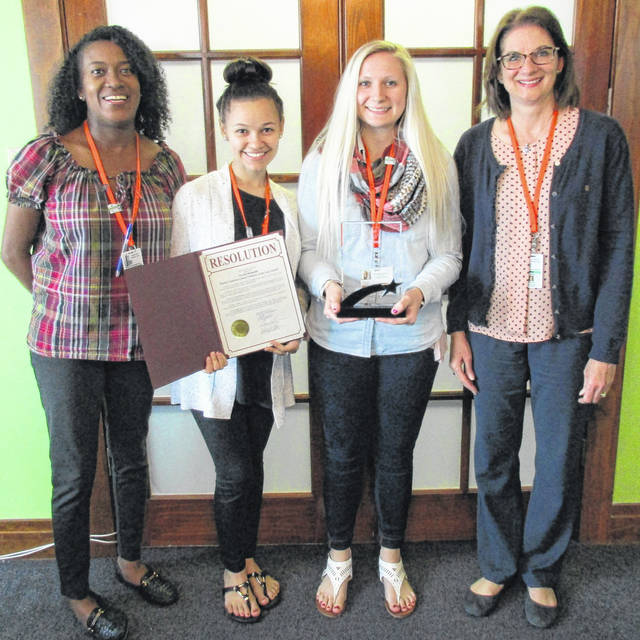 Clinton County CASA volunteer Tarah Mongold, third from the left, was recently recognized for her volunteer efforts in neighboring Greene County. The Greene County Board of Commissioners passed a resolution recognizing May as Supervised Visitation Awareness Month. During May, there were orange ribbons and posters placed in local agencies. During May the Visitation Center recognized Tarah Mongold as Volunteer of the Year. Mongold, and other volunteers in the Visitation Center, donate their time to maintain a safe environment for children while they visit with their non-custodial parent. As a CASA volunteer in Clinton County, Mongold is one of 16 volunteers advocating for abused and neglected children who are involved in the juvenile court system. If you're interested in becoming a CASA volunteer, please contact CASA Director Kim Vandervort at 937-383-1137.