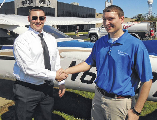 Wilmington resident Zane Stevens, left, with instructor Cody Chesher immediately following his flight.