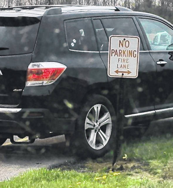 Officials provided examples of what they said are vehicles parked in prohibited areas around the middle school and high school.