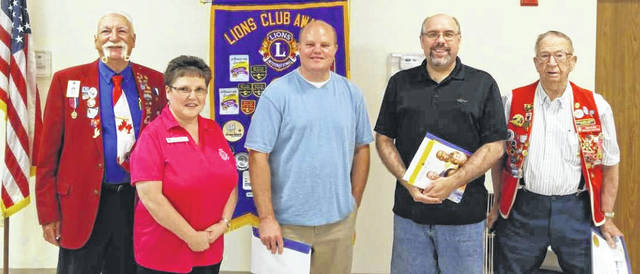 Wilmington Lions Club Immediate Past District Governor Lion Gary De Fayette inducted two new members into the club at the Monday, May 21 meeting. On Thursday, the club will observe its 84th year anniversary of service to the Wilmington community and the world through its donations to Lions Clubs International. The club was chartered May 24, 1934. From left are De Fayette, (Proxy) Sponsor Lion Bev. Beireis, Lion James Bisig, Lion Robby Lann and his sponsor Lion Bob Wilson.