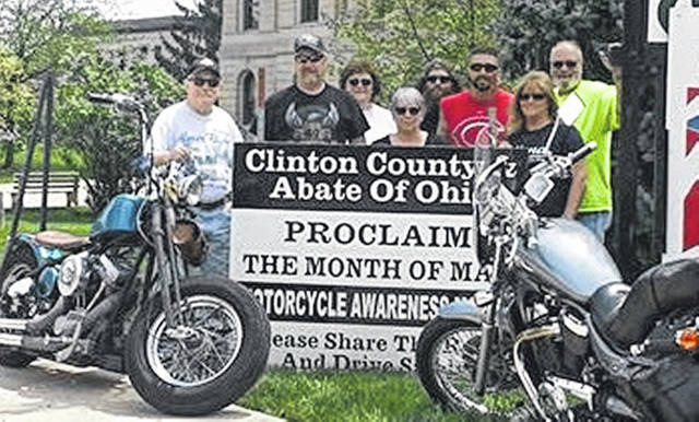 """May is officially Ohio Motorcycle Safety Awareness Month; celebrate with Clinton County ABATE by """"Watching for Motorcycles"""" — don't text, phone, eat or drink while driving, and be in control. From left are Mac Mckibben, Charlie Shoemaker, Jill Bare, Gretchen James, Chris Shumaker, Phil Morris, Theresa Shoemaker and Richard James."""