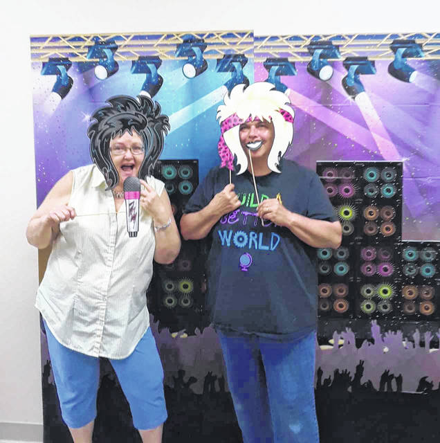 """Rock star librarians Jacki Eakins and Jackie Mitchell are ready to rock the 2018 Summer Reading Program at New Vienna Library. Registration for the program """"Libraries Rock!"""" will start at New Vienna and the Sabina Public Library on Thursday, May 24 and continue until the end of July. Adults, teenagers, and children can read for pleasure to earn a chance to win prizes this summer. The kickoff event featuring Magician Matthew Taylor will take place on Friday, June 8 at 11 a.m. at Sabina and 2 p.m. at New Vienna."""