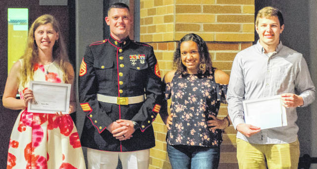 From left are scholarship recipient Heather M. Fryman, Staff Sgt. Mathew Rodgers of the U.S. Marine Corps, Aaliyah Huff who is Mark E. Huff's sister, and scholarship recipient Brady J. Bergefurd. The scholarship is named The L CPL Mark E. Huff Scholarship.