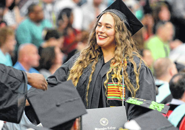 Wilmington resident Lauren Stacey is all smiles after receiving her diploma Saturday during Wilmington College's 142nd Commencement. The college conferred 295 Bachelor of Arts and Bachelor of Science degrees.