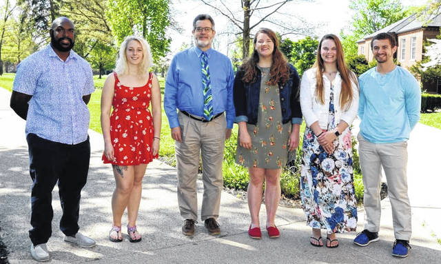 Flanking President Jim Reynolds are the graduating seniors selected for major speaking roles at Commencement-related events this week. They are, from left, David Henry, Maraya Wahl, Sarah Holtsclaw, Allyson Schaefer and Travis Scheadler.