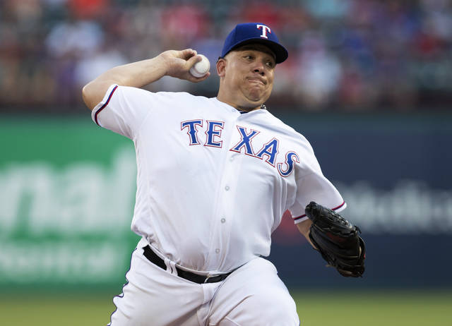 Texas Rangers starting pitcher Bartolo Colon throws to an Oakland Athletics batter during the first inning of a baseball game Wednesday, June 6, 2018, in Arlington, Texas. (AP Photo/Jim Cowsert)