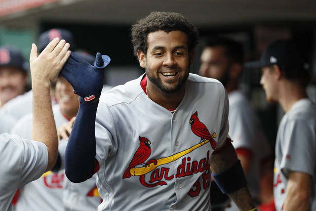 St. Louis Cardinals' Jose Martinez is congratulated in the dugout after hitting a solo home run off St. Louis Cardinals starting pitcher Luke Weaver in the first inning of a baseball game, Friday, June 8, 2018, in Cincinnati. (AP Photo/John Minchillo)
