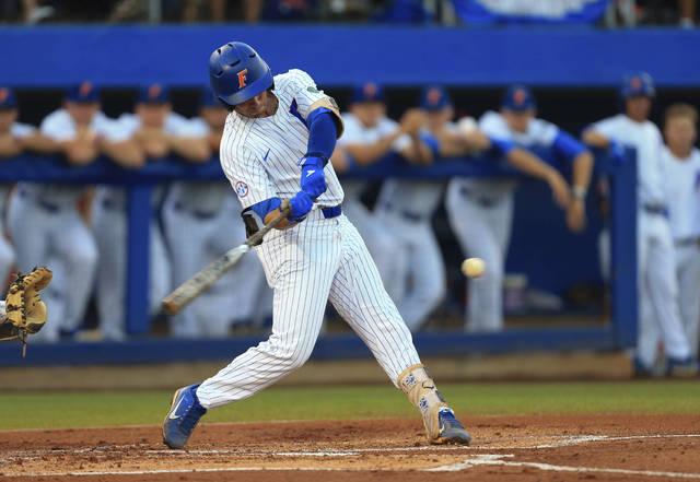 Florida's Jonathan India hits a home run against Auburn during the first inning of an NCAA Super Regional college baseball game Monday, June 11, 2018, in Gainesville, Fla. (AP Photo/Matt Stamey)