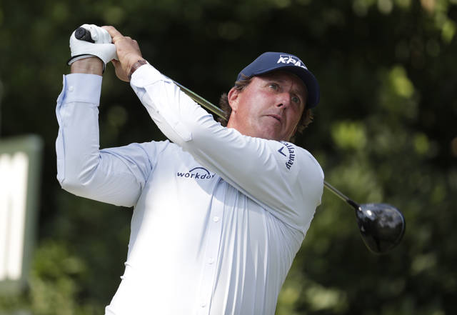 """This photo taken May 10, 2018, shows Phil Mickelson hitting from the 11th tee during the first round of the Players Championship golf tournament in Ponte Vedra Beach, Fla. Mickelson doesn't need to be reminded that this is his 27th appearance in the U.S. Open, more than any of the 156 players at Shinnecock Hills and and needs this title to complete the career Grand Slam. He wouldn't want to be reminded that 65 players, including the last four major champions, were not even born when Mickelson was low amateur in his first U.S. Open in 1990 at Medinah. """"I just can't believe that time has flown by so fast,"""" he said Monday.  (AP Photo/Lynne Sladky,File)"""