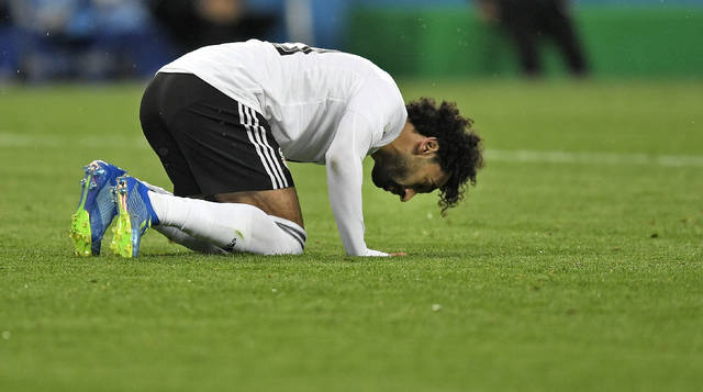 Egypt's Mohamed Salah prays on the ground after scoring a penalty during the group A match between Russia and Egypt at the 2018 soccer World Cup in the St. Petersburg stadium in St. Petersburg, Russia, Tuesday, June 19, 2018. (AP Photo/Martin Meissner)