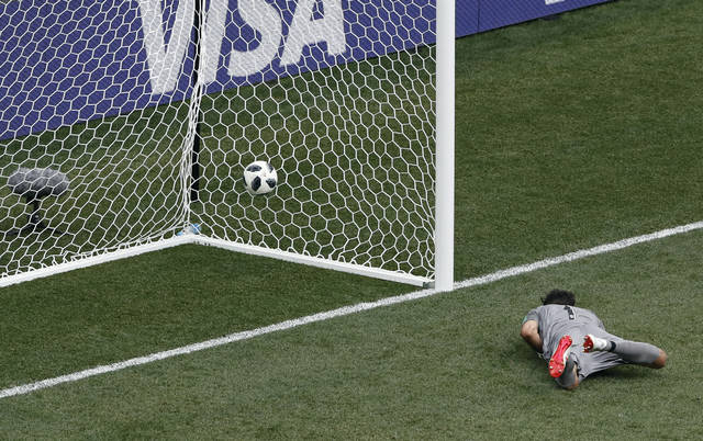 Panama goalkeeper Jaime Penedo lies on the ground after failing to stop a goal from England's Jesse Lingard during the group G match between England and Panama at the 2018 soccer World Cup at the Nizhny Novgorod Stadium in Nizhny Novgorod, Russia, Sunday, June 24, 2018. (AP Photo/Darko Bandic)