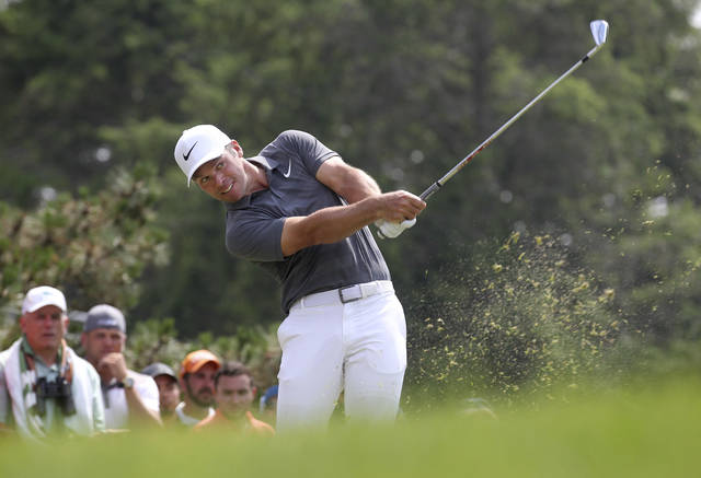 Paul Casey of England hits his tee shot on the fifth hole during the final round of the Travelers Championship golf tournament, Sunday, June 24, 2018, in Cromwell, Conn. (AP Photo/Stew Milne)