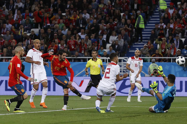 Spain's Isco, 3rd left, scores his side's opening goal during the group B match between Spain and Morocco at the 2018 soccer World Cup at the Kaliningrad Stadium in Kaliningrad, Russia, Monday, June 25, 2018. (AP Photo/Manu Fernandez)