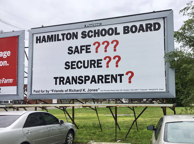 This photo shows Butler County Sheriff Richard Jones' first billboard unveiled at the intersection of Martin Luther King Boulevard and Maple Avenue in Hamilton, Ohio, Monday, June 25, 2018. Jones posted the first of his promised series of billboards criticizing local school districts that he says are moving too slow to upgrade security. The Hamilton school board was the first target of a public, advertising campaign by Butler County's top law enforcement official, who contends the school district isn't doing enough to protect students. (Michael D. Clark/The Journal-News via AP)
