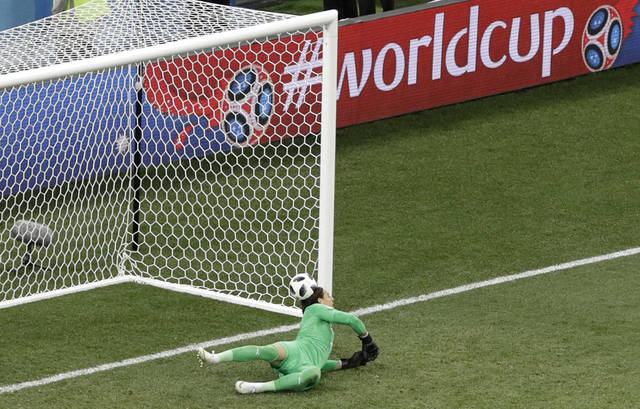 The penalty shot of Costa Rica's Bryan Ruiz hits the head of Switzerland goalkeeper Yann Sommer after bouncing off the bar and goes in during the group E match between Switzerland and Costa Rica, at the 2018 soccer World Cup in the Nizhny Novgorod Stadium in Nizhny Novgorod , Russia, Wednesday, June 27, 2018. (AP Photo/Mark Baker)