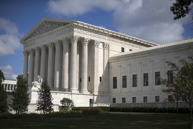 FILE - In this Oct. 5, 2015 file photo, the Supreme Court is seen in Washington. Teachers unions are hoping that recent grass-roots protests over pay and working conditions will blunt the impact of a U.S. Supreme Court ruling on union fees and help persuade dues-paying members not to abandon them. (AP Photo/Carolyn Kaster, File)