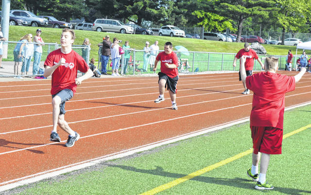 Participants give their all in this heat of the 50-meter dash Saturday at the Clinton County Special Olympics. In addition to the track events, there were softball throws at the Wilmington College football field. The emcee was Butch Peelle. For more photos of the event, see inside today's News Journal.